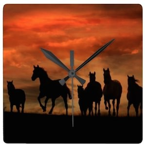 Horses At Sunset Wall Clock